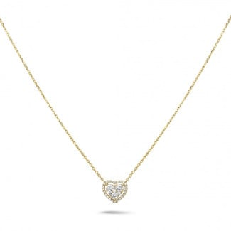 0.65 carat heart-shaped necklace in yellow gold with round diamonds