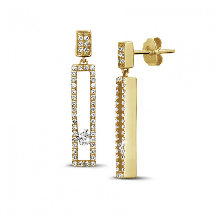 0.55 carat earrings in yellow gold with floating round diamonds