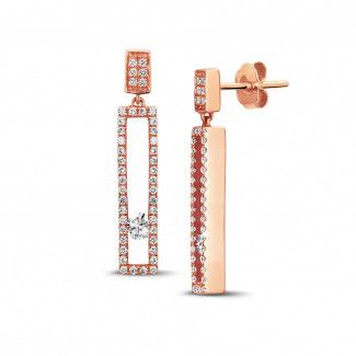 0.55 carat earrings in red gold with floating round diamonds