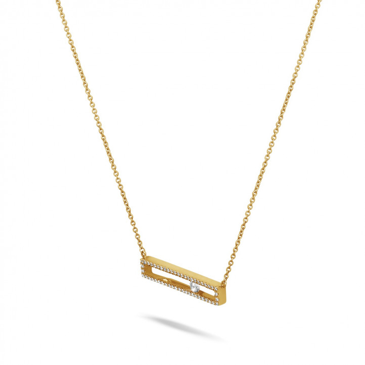 0.30 carat necklace in yellow gold with a floating round diamond