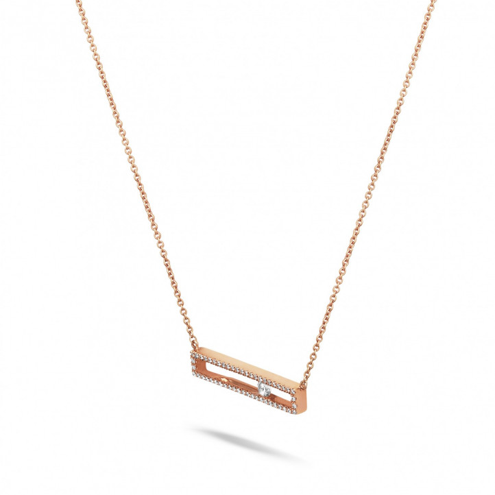 0.30 carat necklace in red gold with a floating round diamond