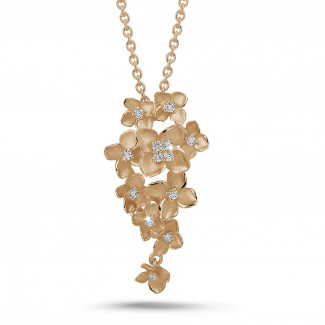 Red Gold - 0.35 carat diamond design floral pendant in red gold