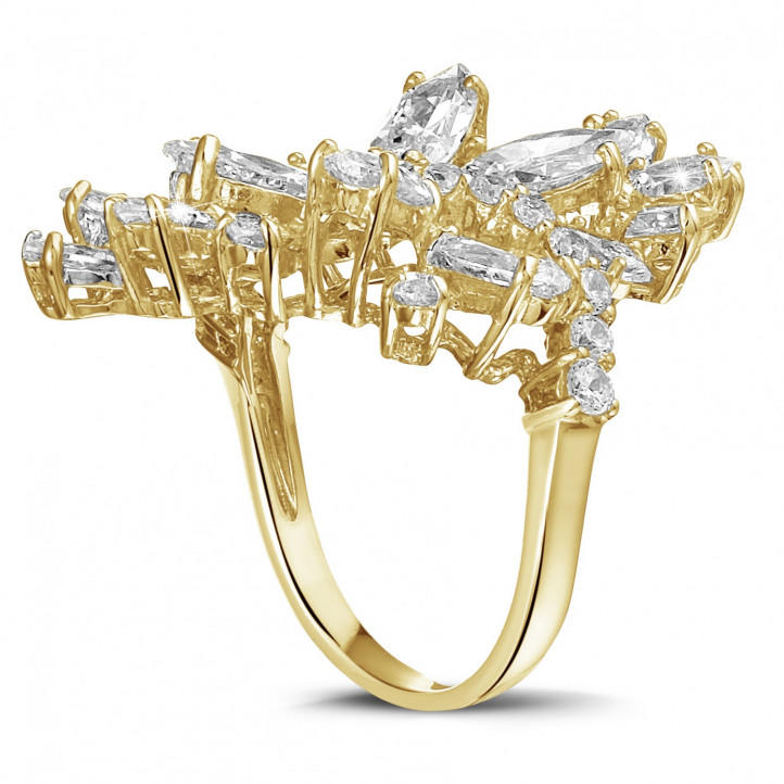 6.00 carat ring in yellow gold with marquise and round diamonds