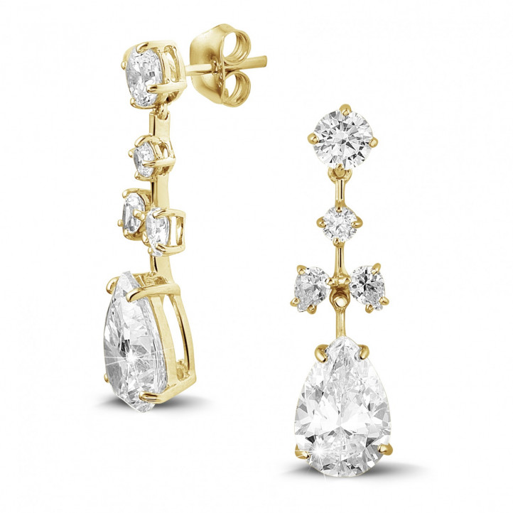 7.00 carat earrings in yellow gold with round and pear-shaped diamonds