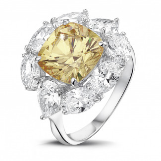 High Jewellery - Entourage ring in white gold with 'fancy intense yellow' cushion diamond and oval and pear shaped  diamonds