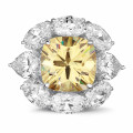Entourage ring in white gold with 'fancy intense yellow' cushion diamond and oval and pear shaped  diamonds