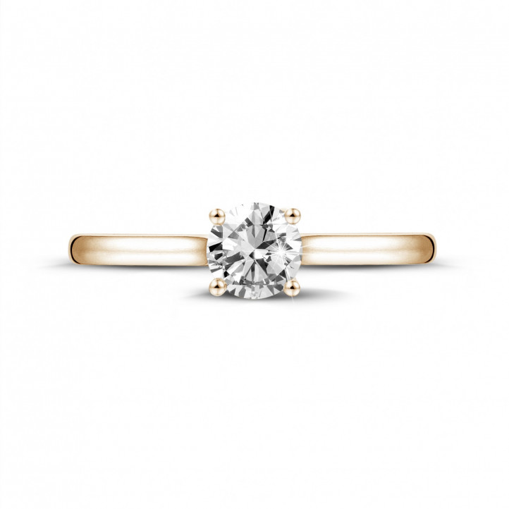 0.50 carat solitaire ring in red gold with round diamond and four prongs