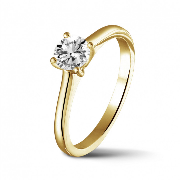 0.50 carat solitaire ring in yellow gold with round diamond and four prongs