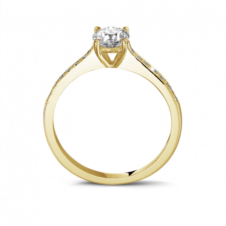 0.50 carat solitaire ring in yellow gold with four prongs and side diamonds