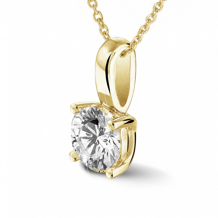 0.50 carat solitaire pendant in yellow gold with round diamond and four prongs