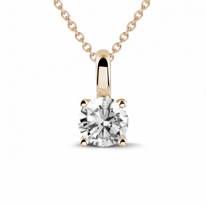 0.50 carat solitaire pendant in red gold with round diamond and four prongs