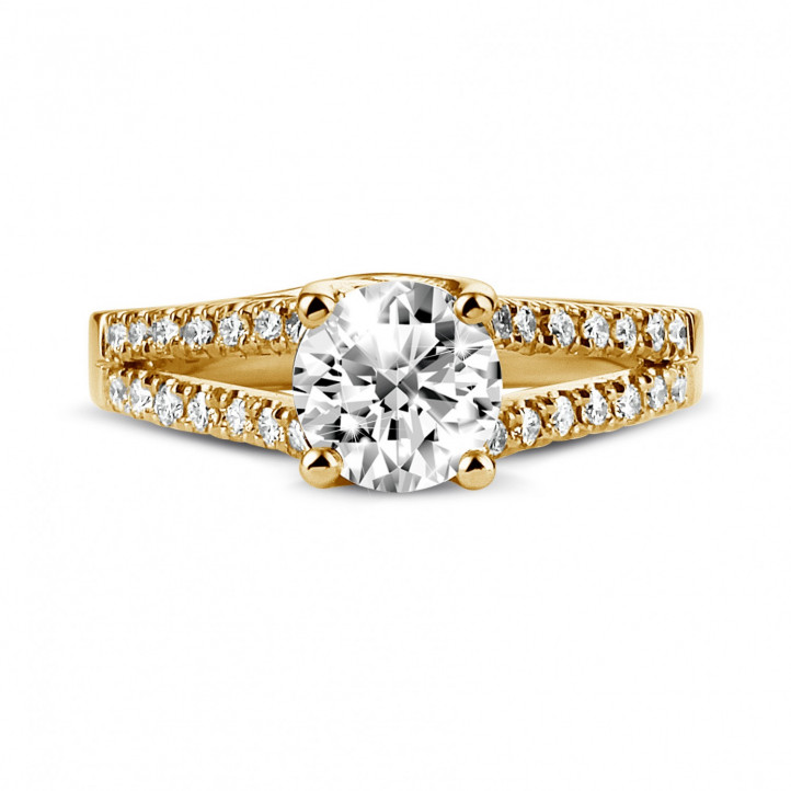 0.90 carat solitaire ring in yellow gold with side diamonds