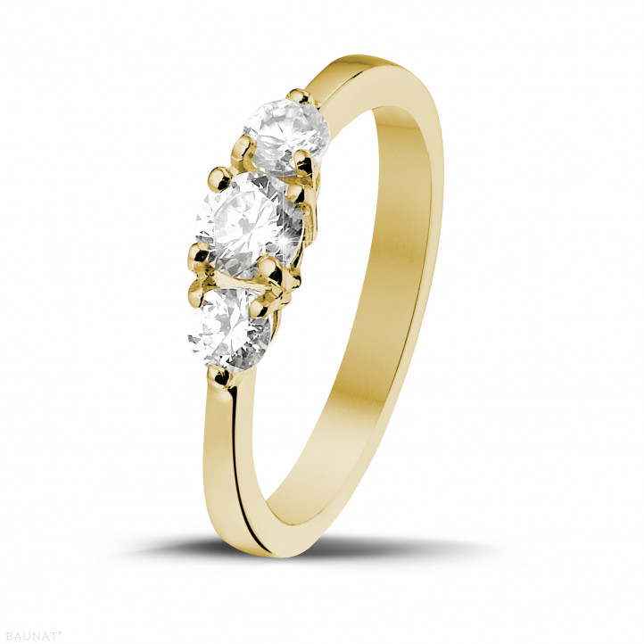 0.67 carat trilogy ring in yellow gold with round diamonds