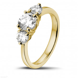 1.50 carat trilogy ring in yellow gold with round diamonds
