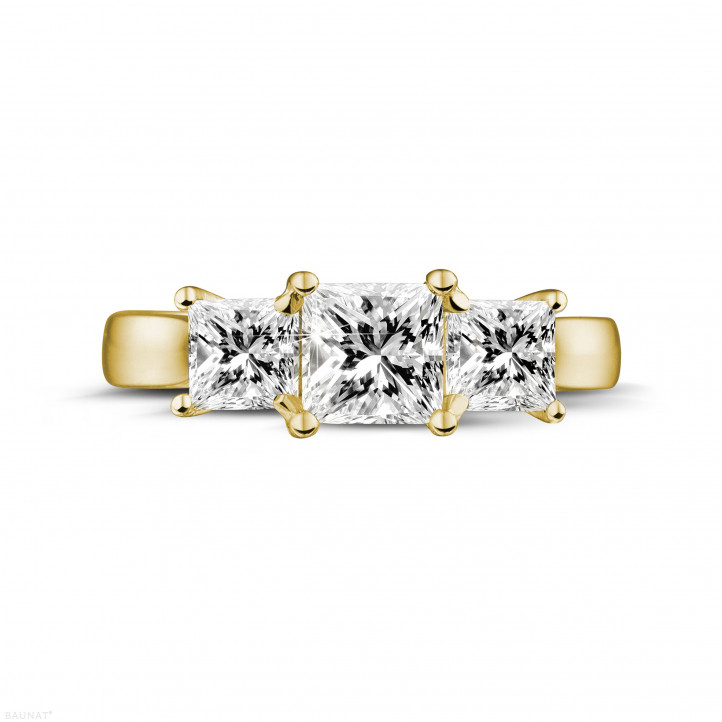 1.50 carat trilogy ring in yellow gold with princess diamonds
