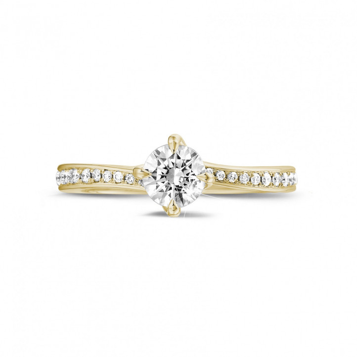 0.50 quilates anillo solitario diamante en oro amarillo con diamantes en los lados