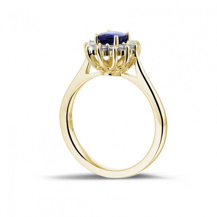 Anillo « entourage » en oro amarillo con zafiro ovalado y diamantes redondos