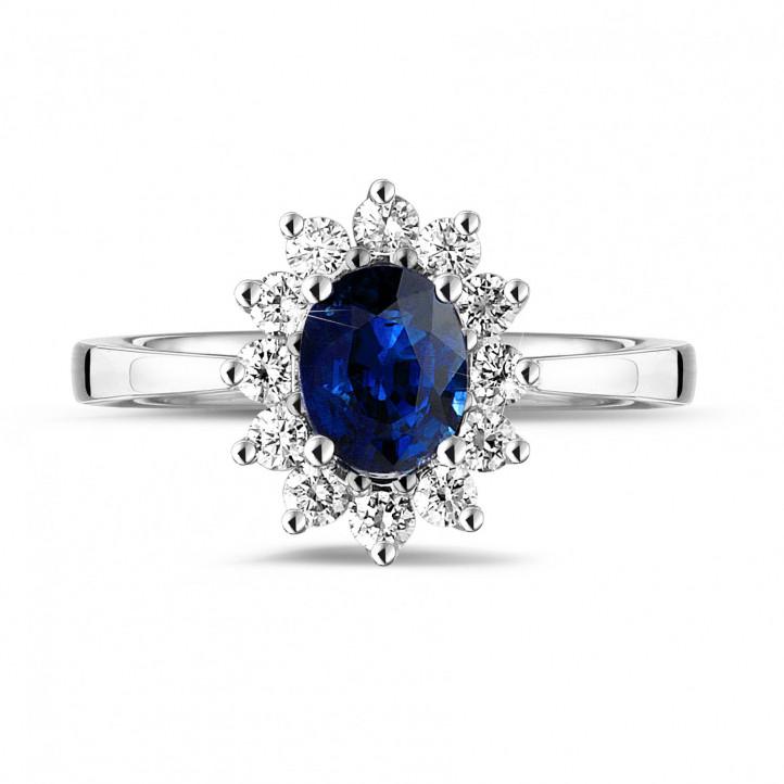Anillo « entourage » en platino con zafiro ovalado y diamantes redondos