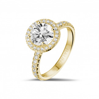 1.50 quilates Halo anillo solitario en oro amarillo con diamantes redondos