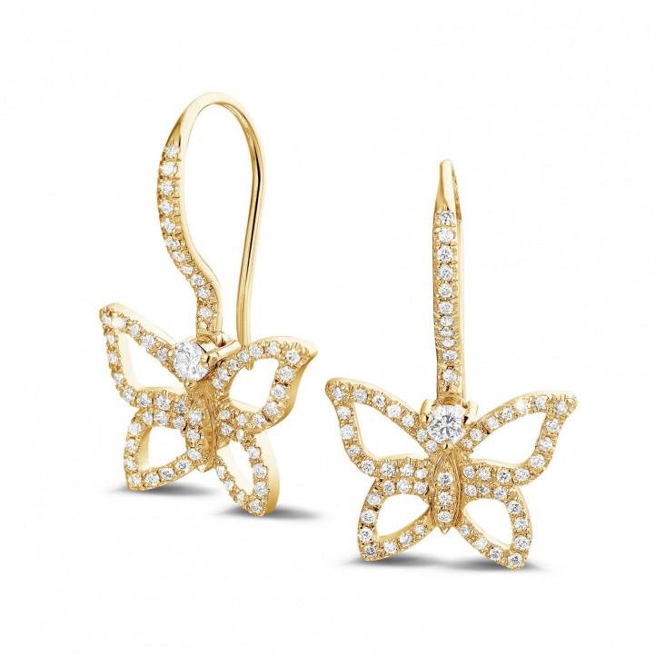 0.70 quilates pendientes diamantes diseño mariposa en oro amarillo
