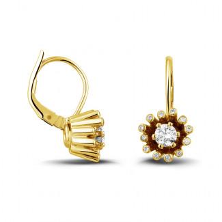 0.50 quilates pendientes diamantes diseño en oro amarillo