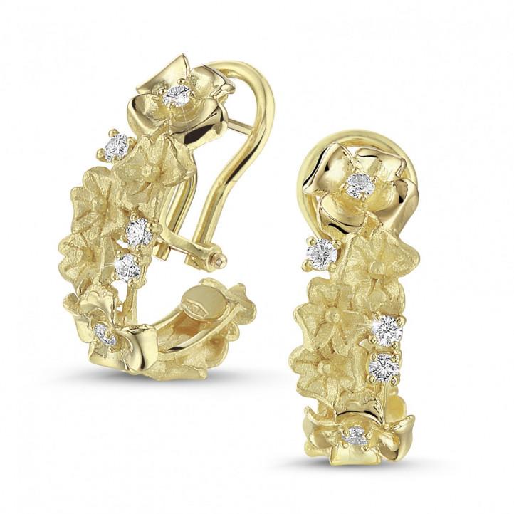 0.50 quilates pendientes diamantes diseño flor en oro amarillo