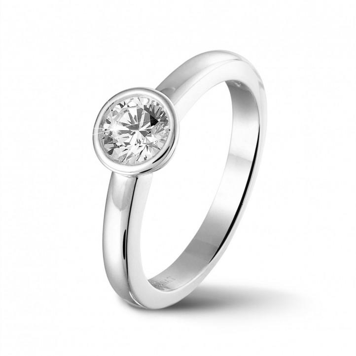 0.50 quilates anillo solitario en platino con un diamante redondo
