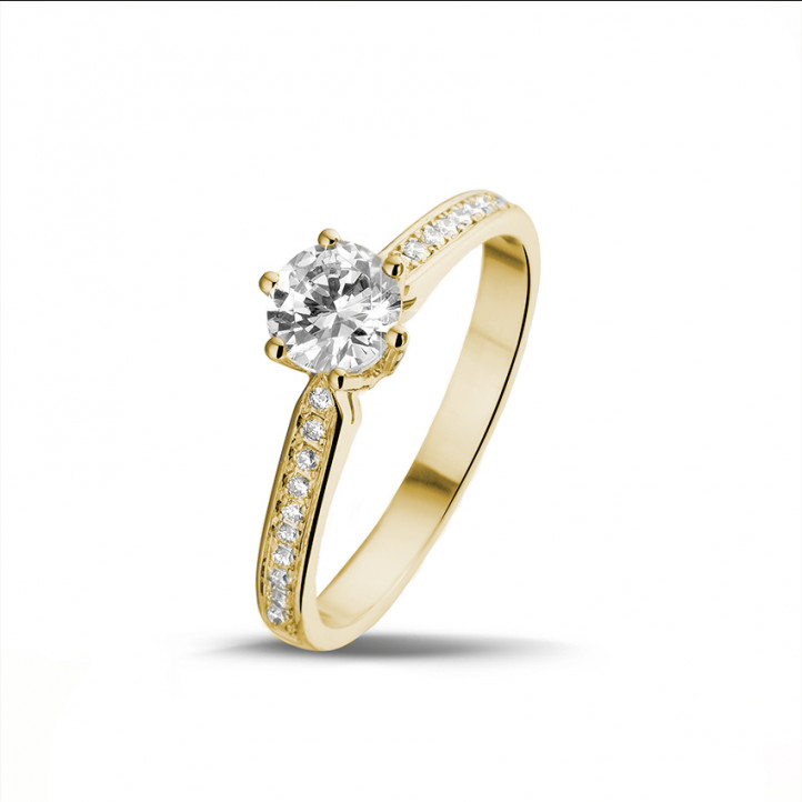 0.75 carats bague diamant solitaire en or jaune avec diamants sur les côtés