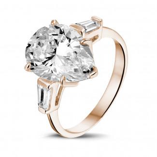 Bagues - Bague en or rouge avec diamant de la taille poire et diamants baguette coniques