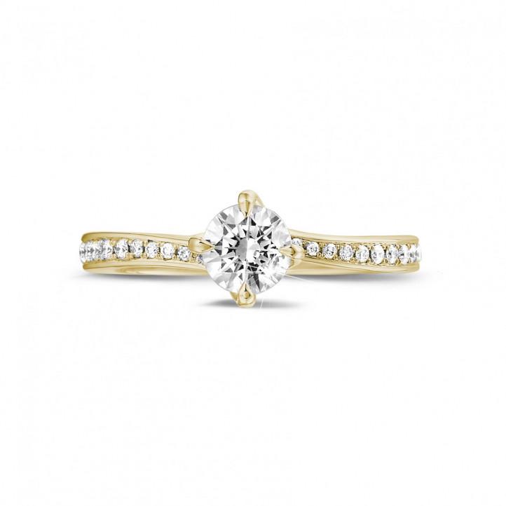 0.50 carats bague diamant en or jaune avec diamants sur les côtés