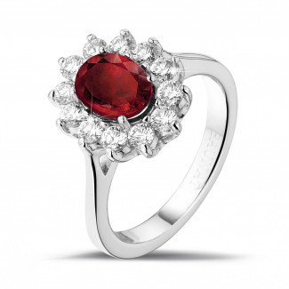 Bague entourage en or blanc avec un rubis ovale et diamants ronds