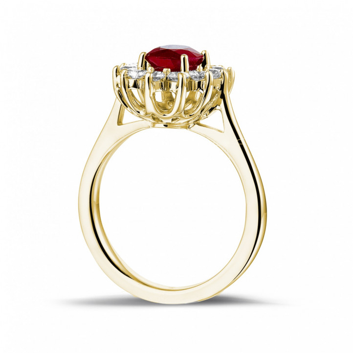 Bague entourage en or jaune avec un rubis ovale et diamants ronds