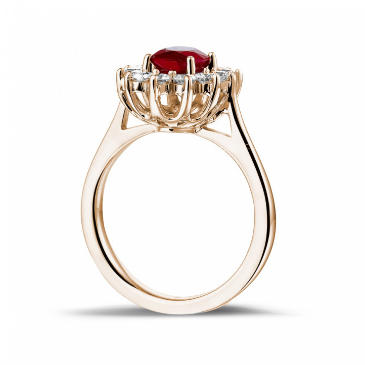 Bague entourage en or rouge avec un rubis ovale et diamants ronds