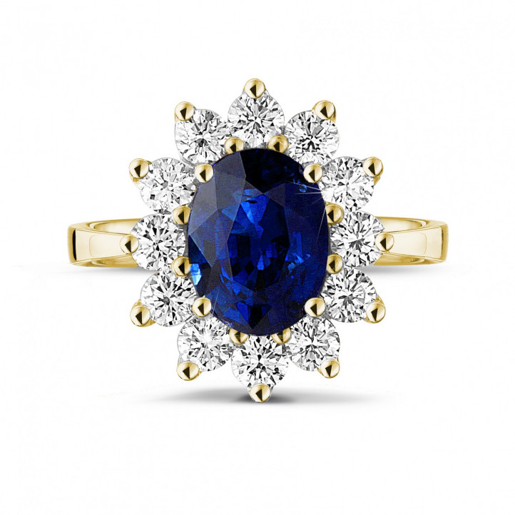 Bague entourage en or jaune avec un saphir ovale et diamants ronds