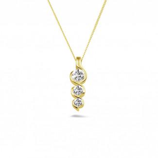 Classics - 0.57 carat pendentif trilogie en or jaune avec diamants