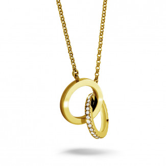 Or Jaune  - 0.20 carat pendentif design infinity en or jaune avec diamants