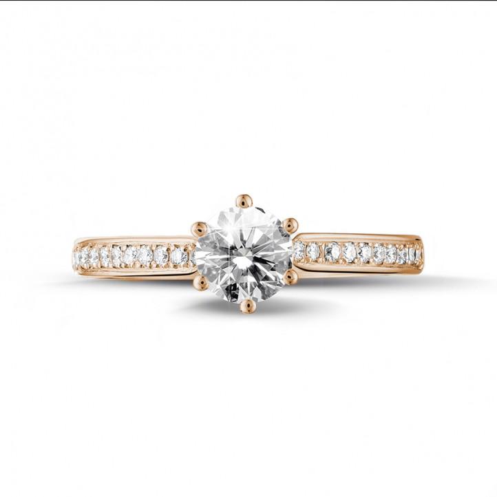 0.75 carats bague diamant solitaire en or rouge avec diamants sur les côtés