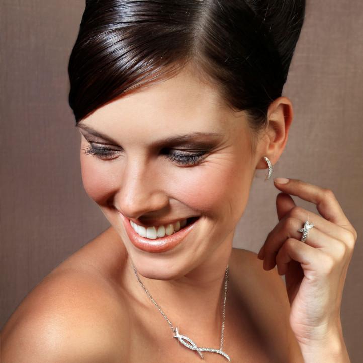 0.36 carat boucles d'oreilles design en or blanc et diamants