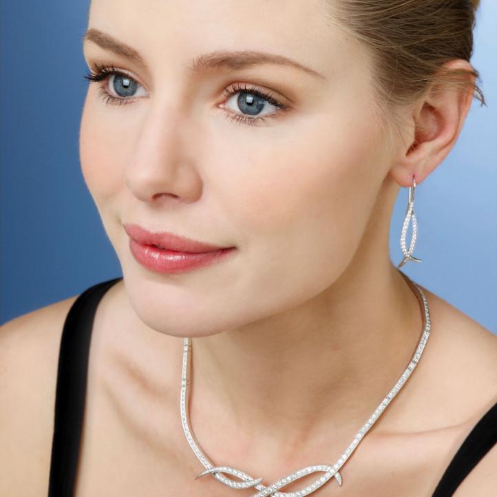 0.76 carat boucles d'oreilles design en or rouge et diamants