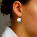 0.26 carat boucles d'oreilles design en or blanc avec diamants