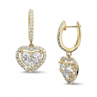 1.35 carat boucles d'oreilles en forme de coeur en or jaune avec diamants ronds