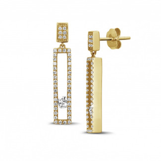 0.55 carat boucles d'oreilles en or jaune avec diamants ronds flottants