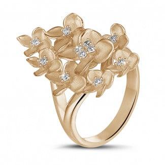 Or Rouge - 0.30 carats bague design fleurs en or rouge avec diamants