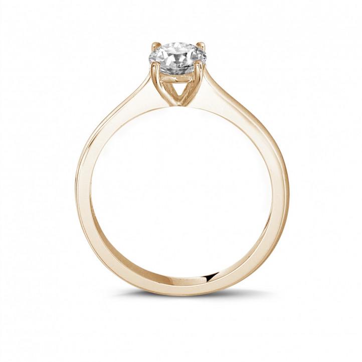 0.50 carats bague solitaire en or rouge avec un diamant rond et quatre griffes