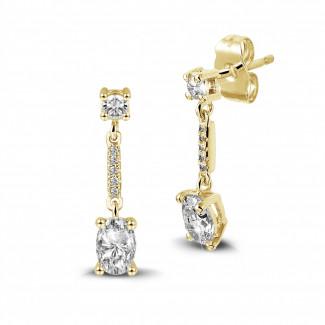 Boucles d'oreilles - 1.04 carat boucles d'oreilles en or jaune et diamants ovales