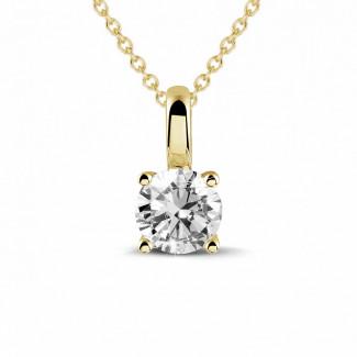 Colliers - 0.50 carat pendentif solitaire en or jaune avec diamant rond et quatre griffes