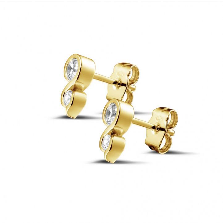 0.44 カラットのイエローゴールドダイヤモンドイヤリング