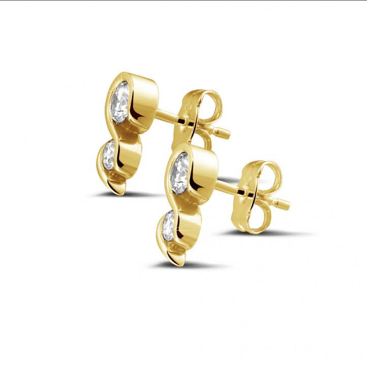 0.70 カラットのイエローゴールドダイヤモンドイヤリング