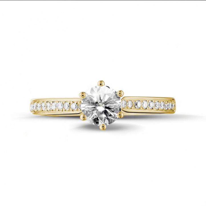 0.75 カラットのサイドダイヤモンド付きイエローゴールドソリテールダイヤモンドリング