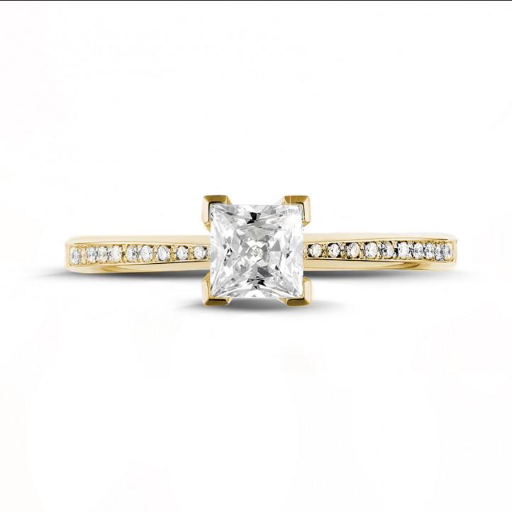 0.75 カラットのプリンセスダイヤモンドとサイドダイヤモンド付きイエローゴールドソリテールリング
